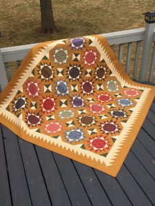 scrappy stars cheddar border antique inspired lap quilt