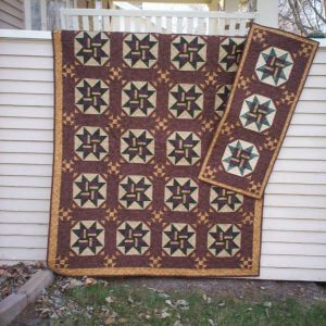 scrappy pieced stars lap quilt and table runner