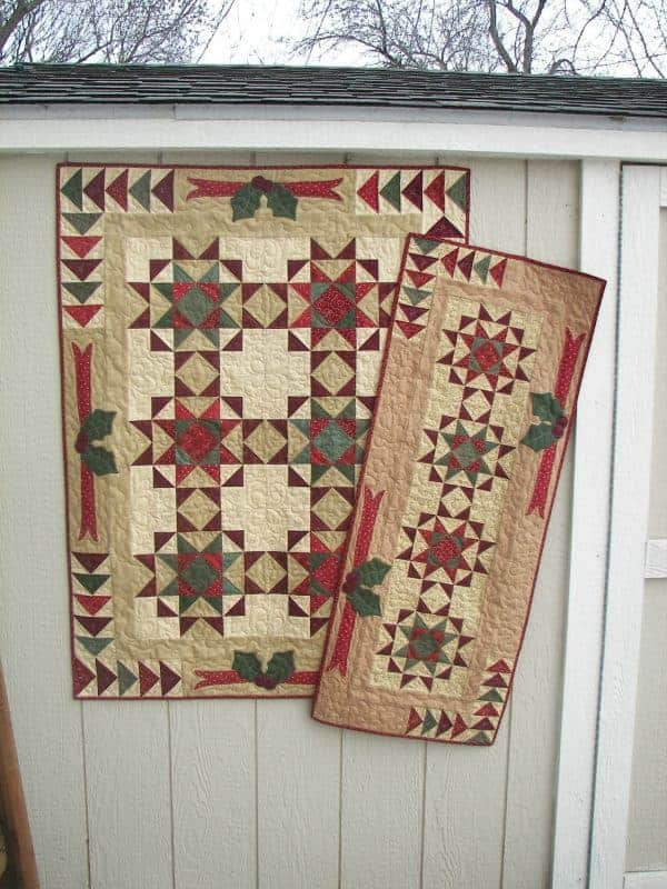Christmas stars and holly pieced and appliqued wall hanging and table runner