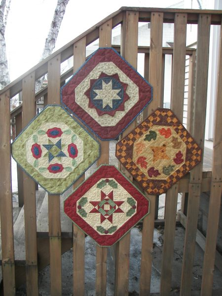 pieced and applique seasonal table mats