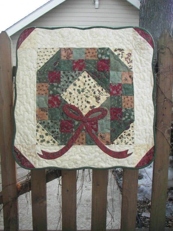 Charm pack Christmas wreath pieced and appliqued