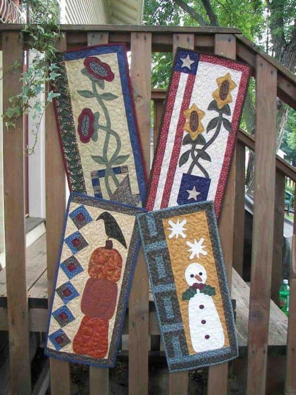 Mini seasonal pieced and applique wall hangings
