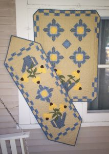 pieced and applique spring floral wall hanging and table runner