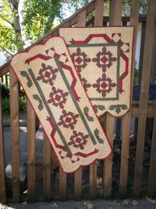 Christmas pieced and applique wall hanging and table runner