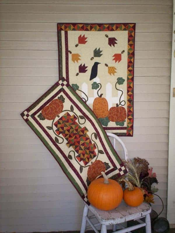 Pieced and applique fall pumpkins wall hanging and table runner