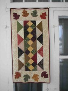 charm pack pieced and applique fall table runner