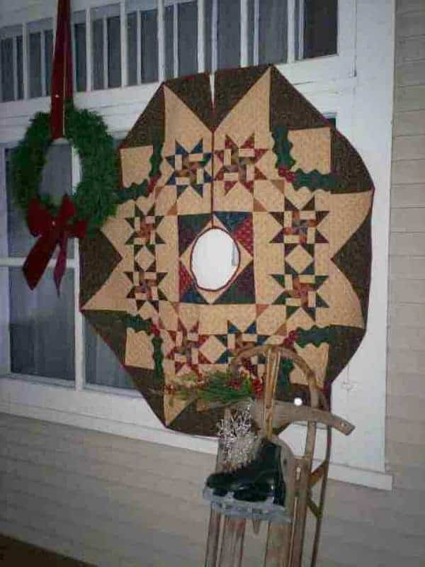 Stars and holly Christmas tree skirt pieced and appliqued