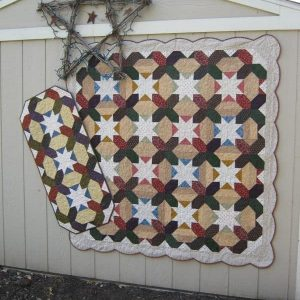 Scrappy woven stars lap quilt and table runner