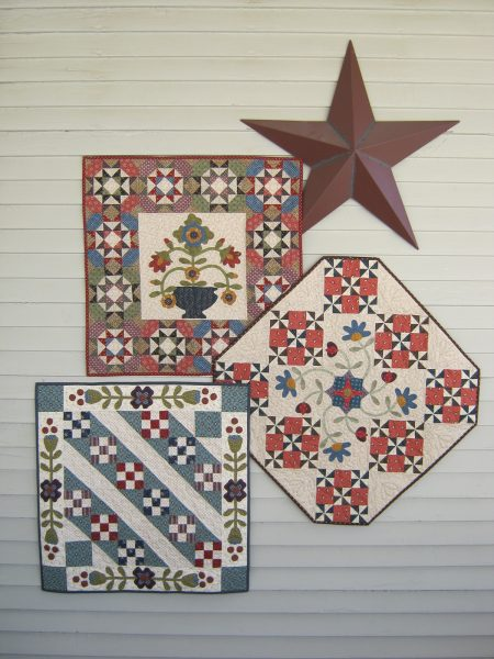 Mini pieced blocks table topper and wall hanging with floral applique