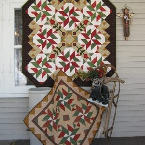 scrappy red and green pieced and appliqued Christmas decor