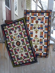 Pieced and appliqued scrappy quick table runners