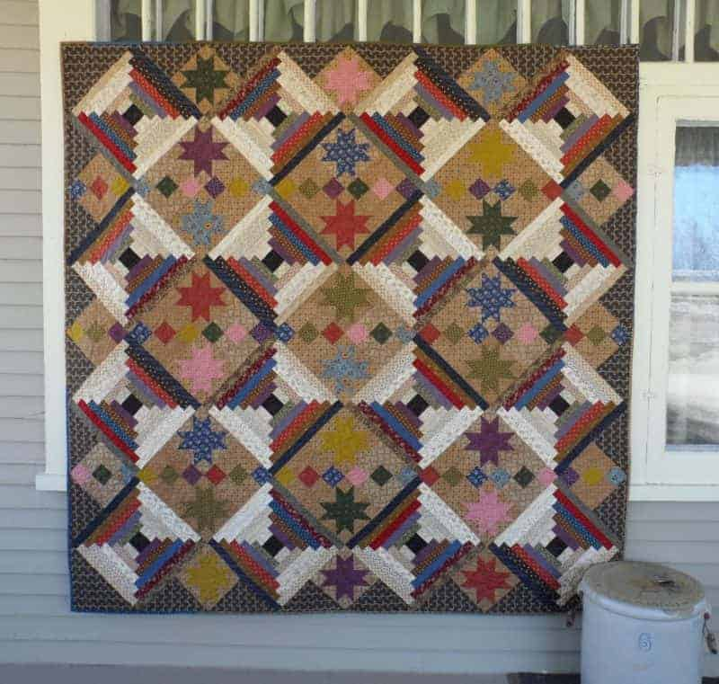 scrappy log cabin and stars lap quilt