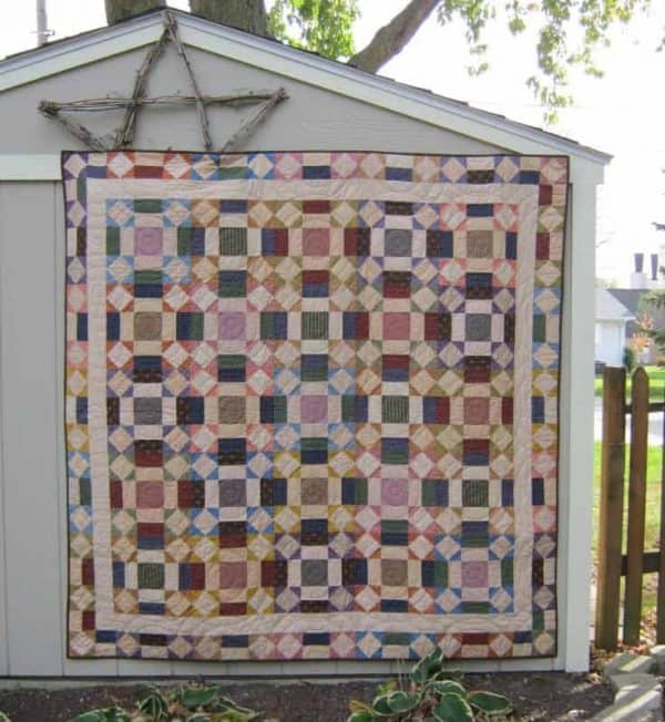 Quick scrappy one block lap quilt
