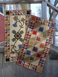 scrappy stars and triangle squares table runners
