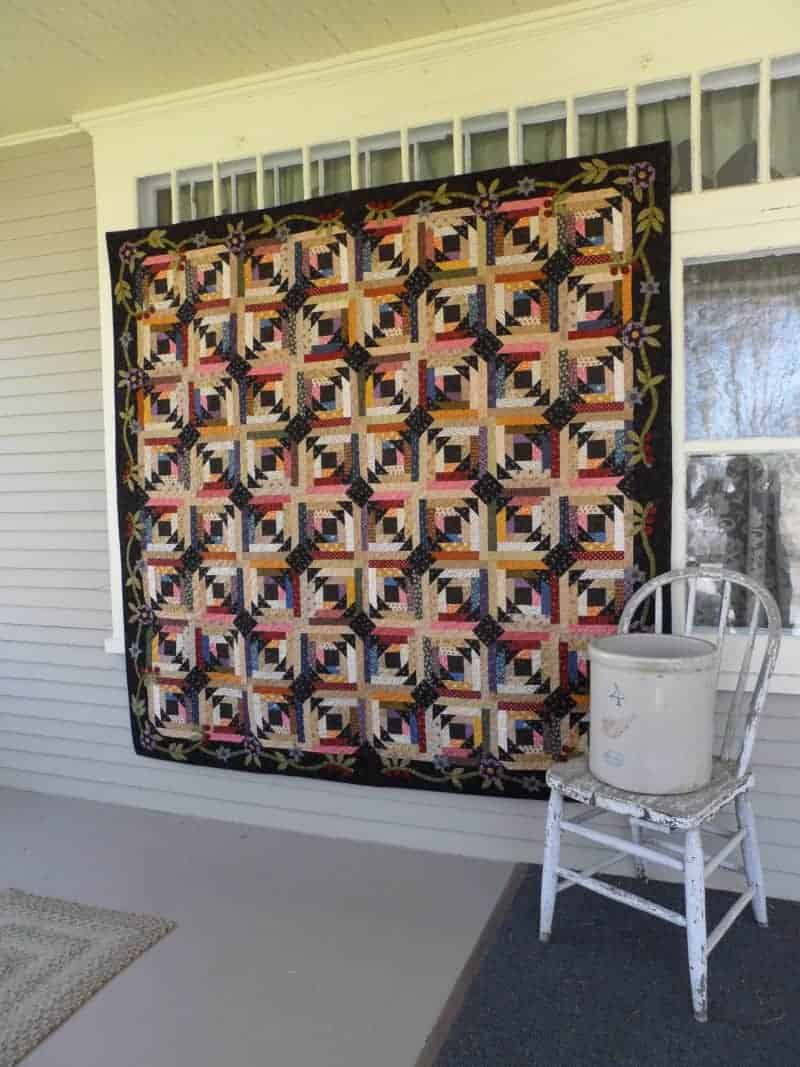 scrappy pieced and appliqued pineapple style lap quilt