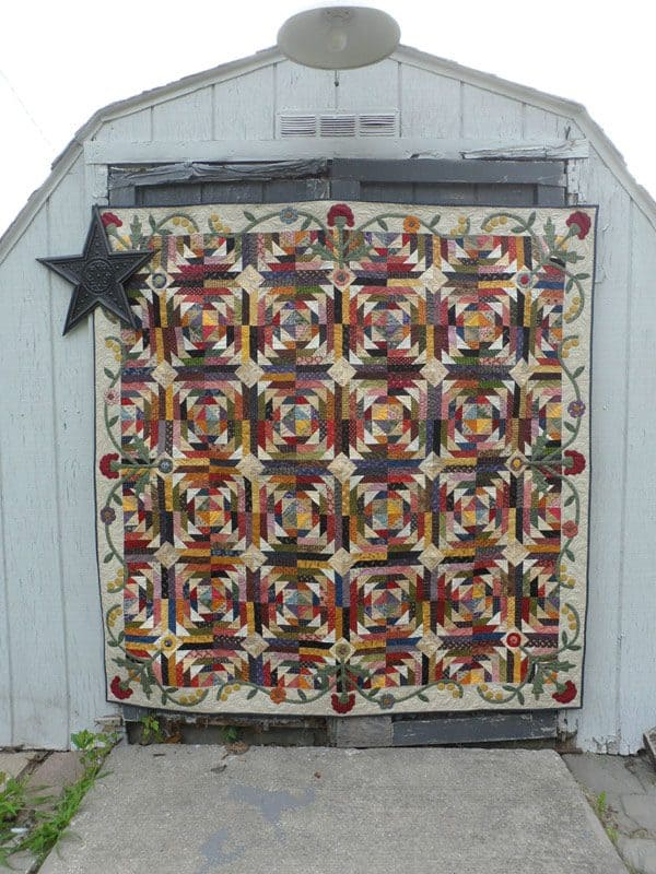 Scrappy pineapple style log cabin lap quilt