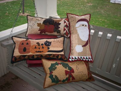 Mini seasonal pillows pieced and appliqued