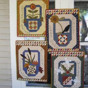 Pieced and appliqued seasonal small wall hangings with embroidery